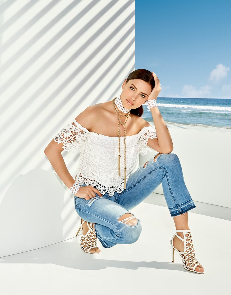 Wearing a lace top and ripped denim pants, Irina Shayk stars in Bebe's summer 2016 campaign