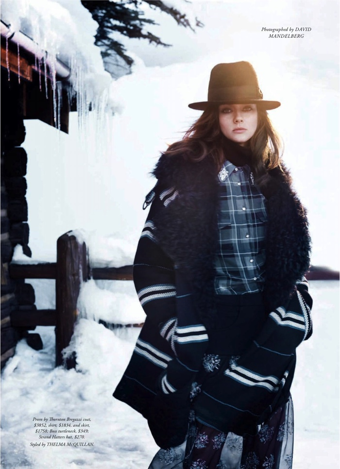 The model poses in winter fashion outfits for the editorial