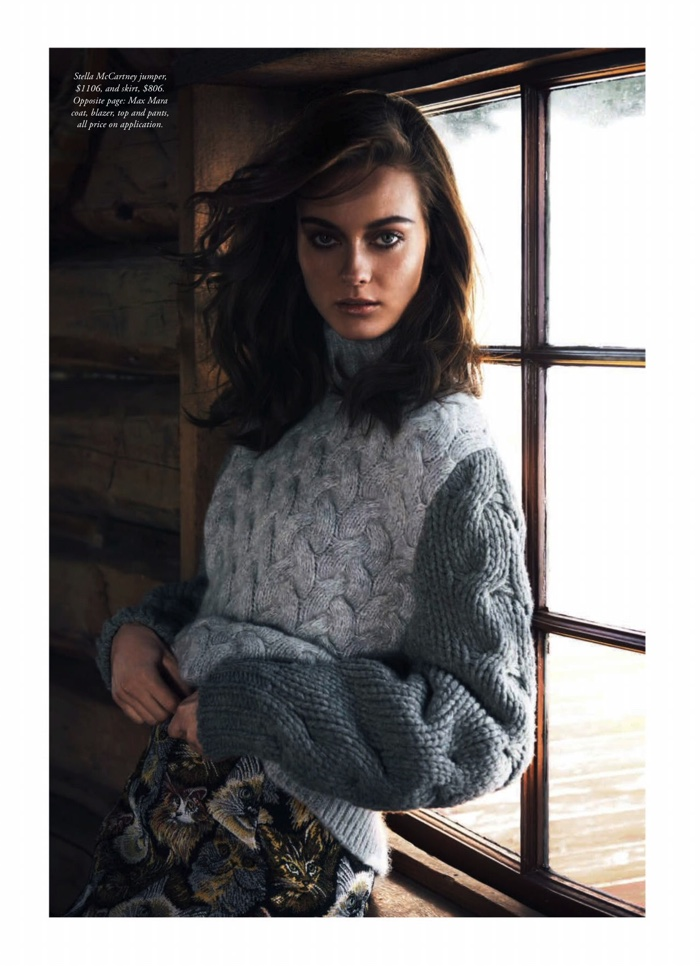 Jac Jagaciak poses in knit sweater from Stella McCartney with printed skirt