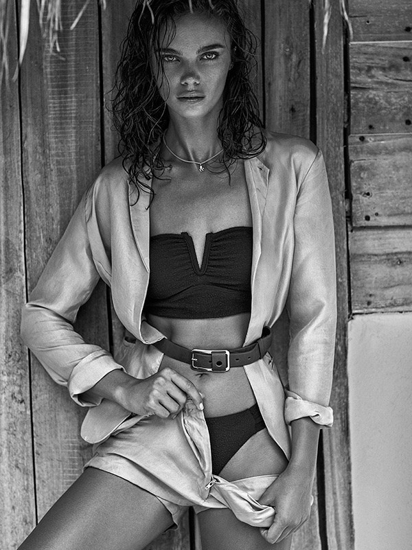 Captured in black and white, Jena Goldsack wears zip-up jacket with bandeau bikini top and bottoms