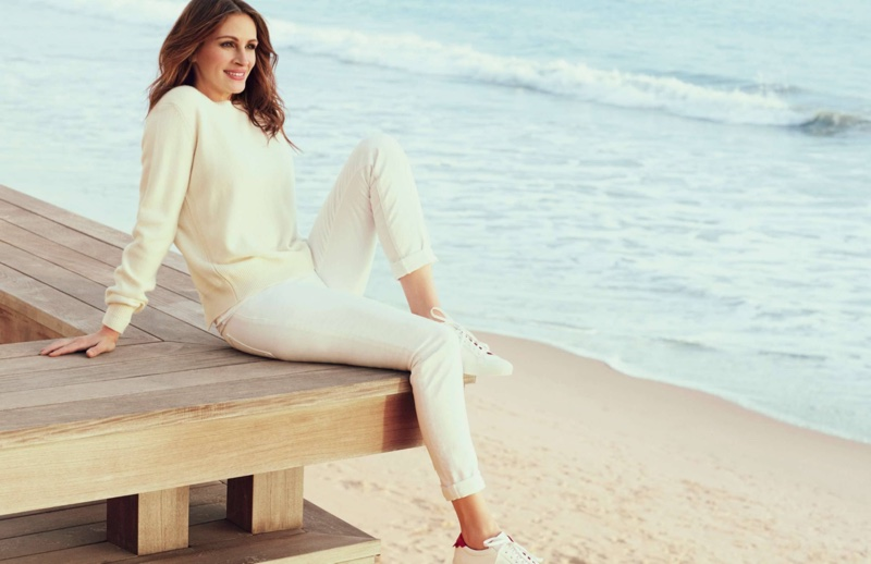 Posing on the beach, Julia Roberts wears a white sweater and jeans