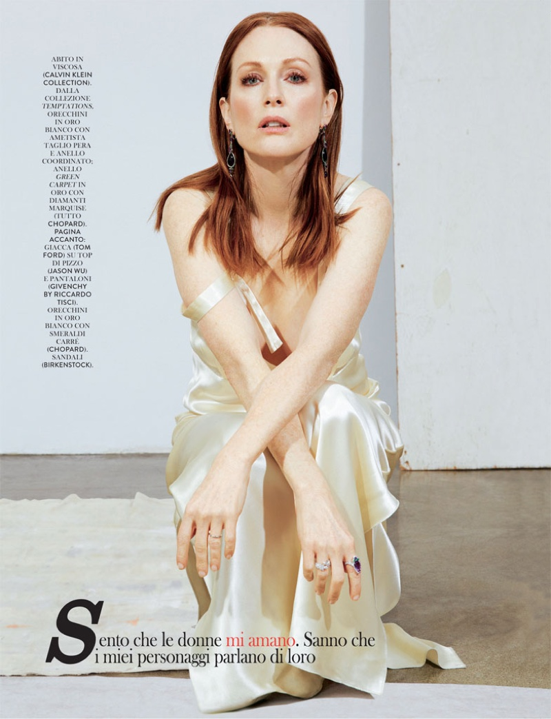 Taking a seat, Julianne Moore poses in white Calvin Klein Collection slip dress