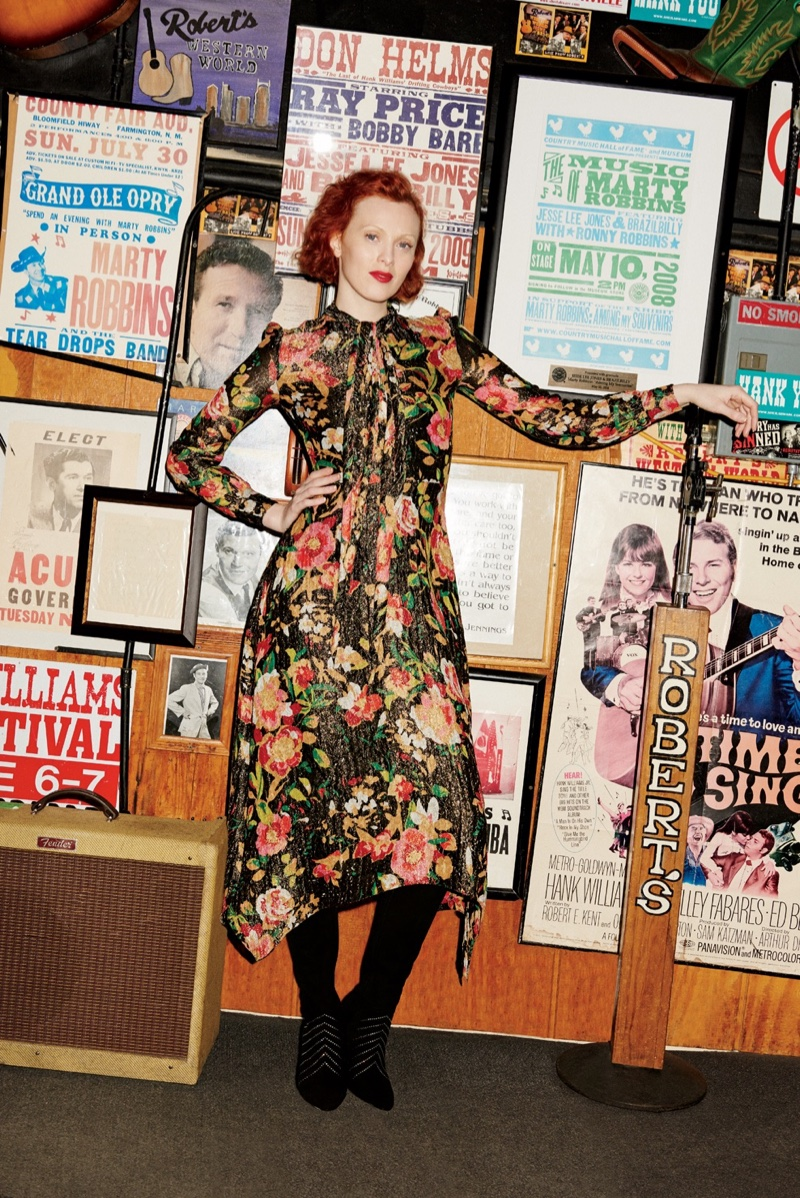 The redhead model wears a floral print dress from Saint Laurent