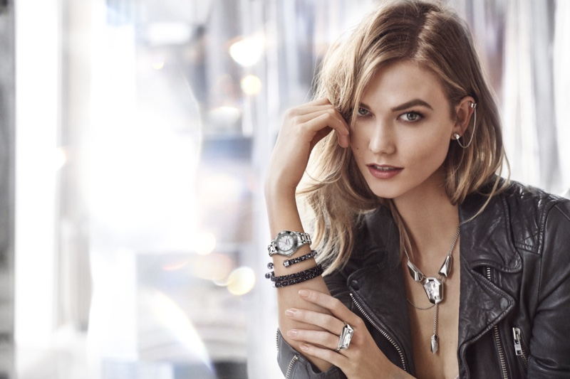 Posing in a leather jacket, Karlie Kloss models pieces from Swarovski