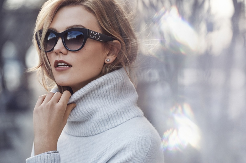 With her sunglasses on, Karlie Kloss models a turtleneck and Swarovski jewelry