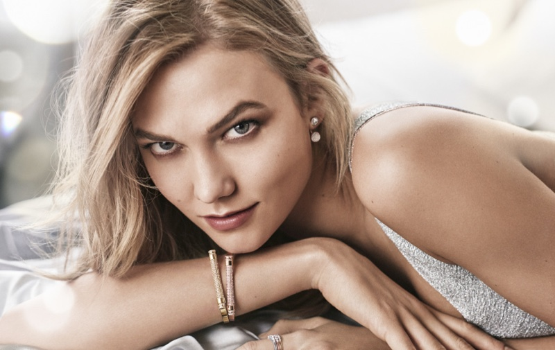 Karlie Kloss signed a two year deal as the face of crystal and jewelry brand Swarovski