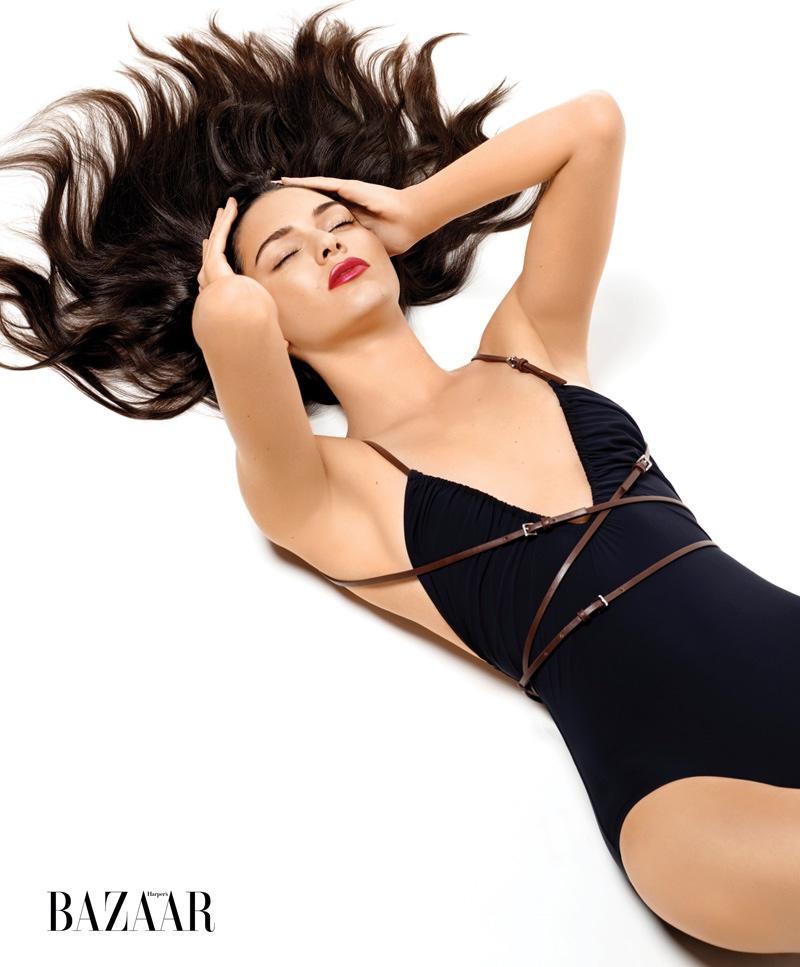 Kendall Jenner wears a black one-piece Michael Kors swimsuit