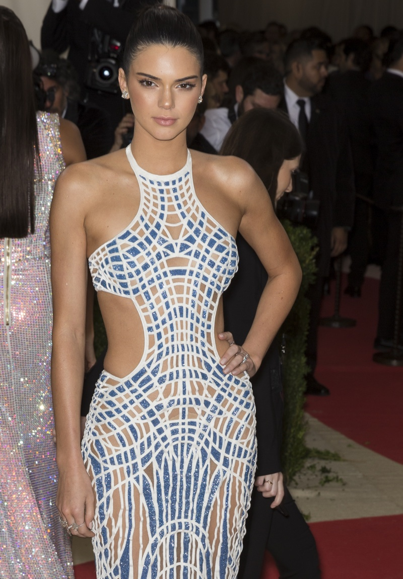MAY 2016: Kendall Jenner attends the 2016 Met Gala wearing an Atelier Versace dress with side cutouts. Photo: Ovidiu Hrubaru / Shutterstock.com