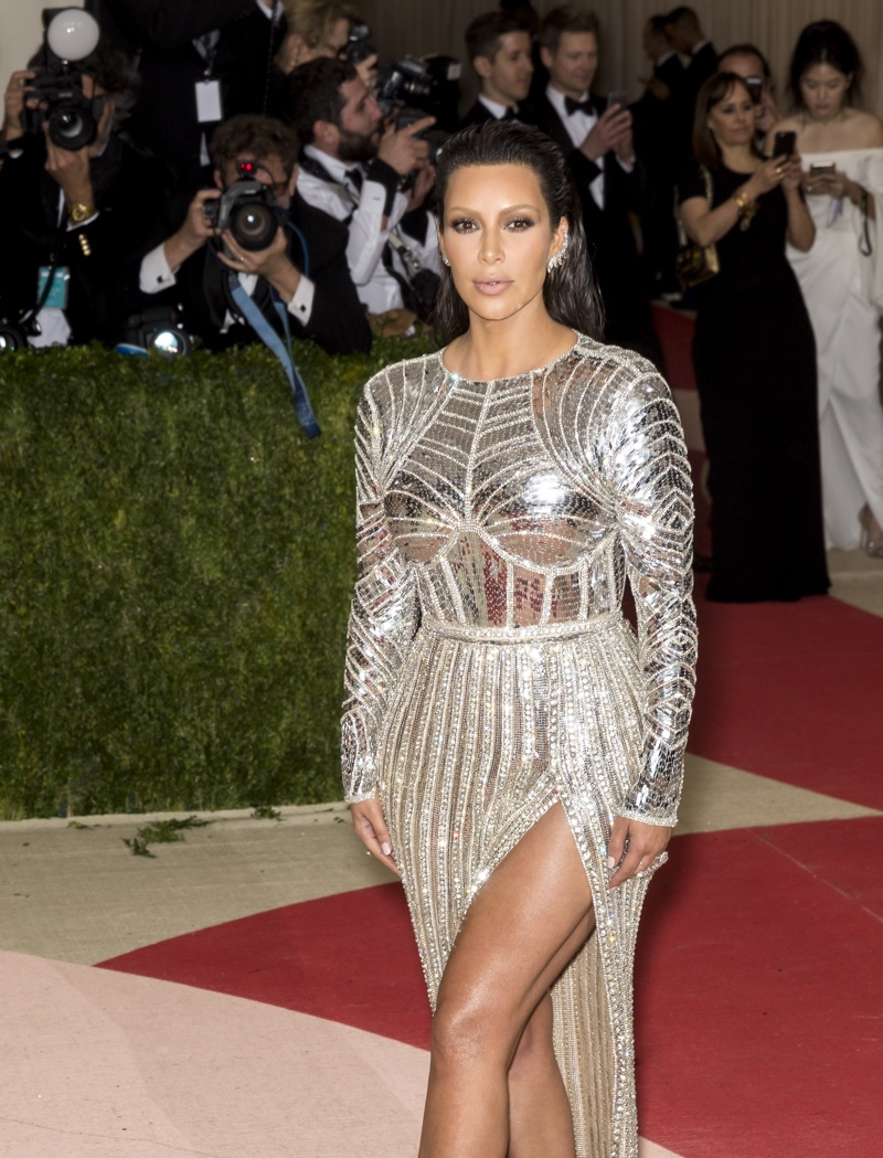 MAY 2016: Kim Kardashian attends the 2016 Met Gala wearing a silver Balmain dress. Photo: Ovidiu Hrubaru / Shutterstock.com