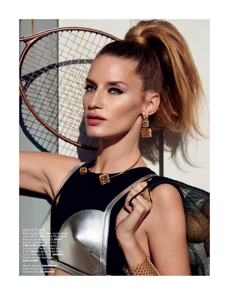 Rocking a high ponytail, Linda Vojtova wears metallic bra top by Zana Bayne