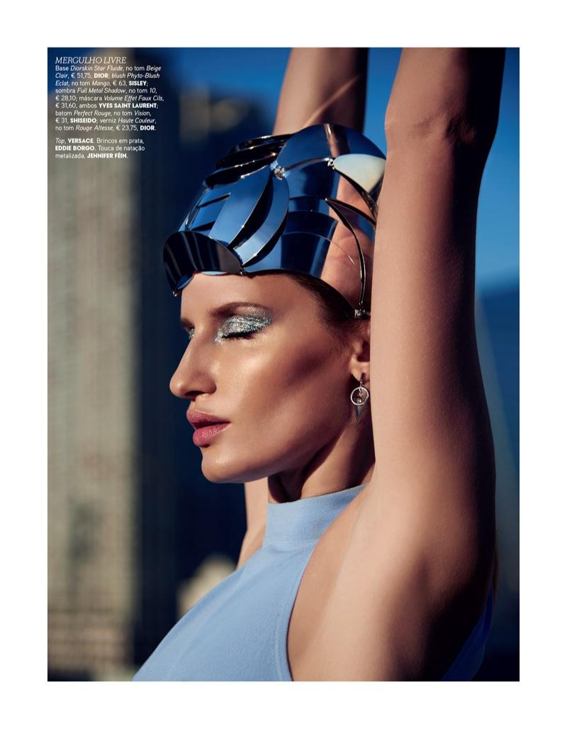 Linda Vojtova looks ready to dive into summer with a metallic eyeshadow makeup look