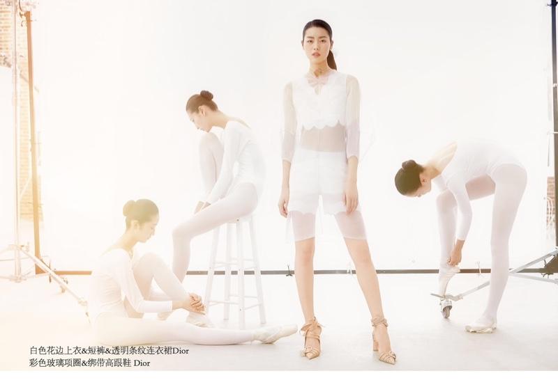 Posing alongside ballet dancers, Liu Wen models Dior sheer dress, crop top and shorts in white