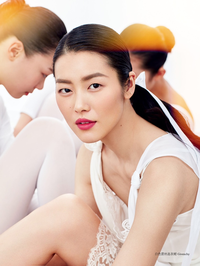 Liu Wen wears a dreamy makeup look with a red lip color and rouged cheeks