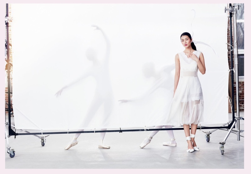 Liu Wen poses in white Dior dress with pumps, also from the brand