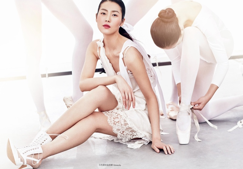 Wearing all white, Liu Wen poses in Givenchy lace-embellished dress with heels also from the brand