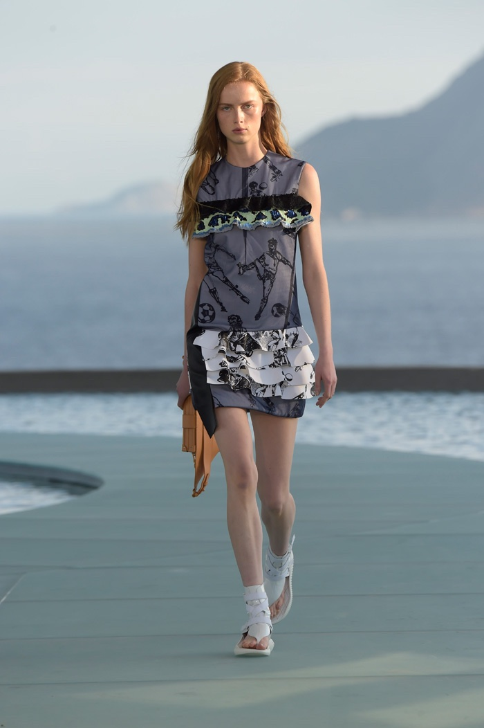 A model walks the runway at Louis Vuitton's resort 2017 show wearing a minidress with ruffle embellishments