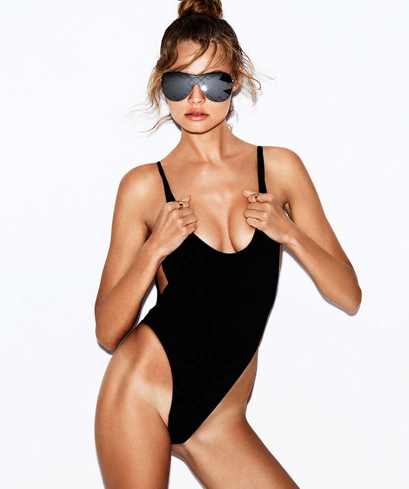 Magdalena Frackowiak poses in a high-waist cut black one-piece swimsuit