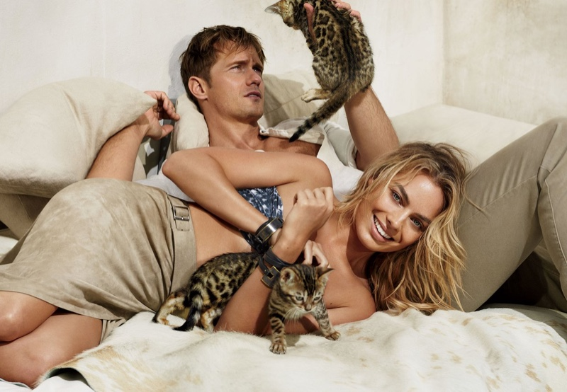 Margot Robbie poses with Legend of Tarzan co-star Alexander Skarsgård while surrounded by kittens