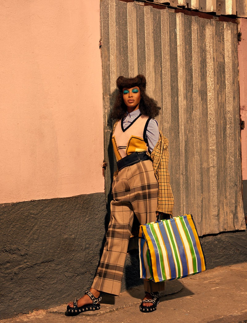 Naomi Campbell poses in Prada vest and Celine trousers
