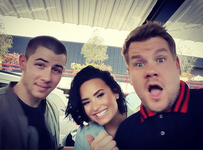 Nick Jonas, Demi Lovato and James Corden pose for a selfie