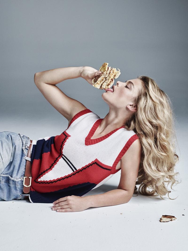 Nina Agdal wears Alexander Wang top and Denim x Alexander Wang while chowing down on a sandwich