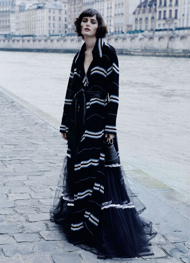 Sibui stands out in wool coat, leather belt and silk tulle skirt from Preen by Thornton Bregazzi with Simon Miller bag