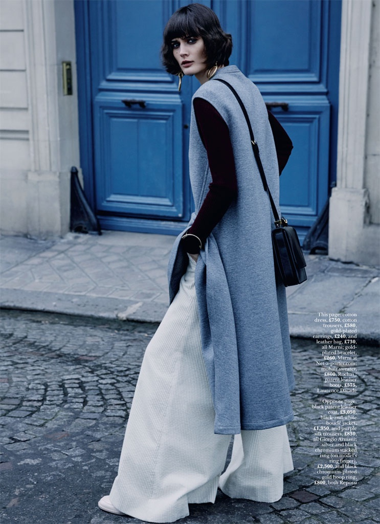 The model layers up in Marni sweater, trousers and crossbody bag