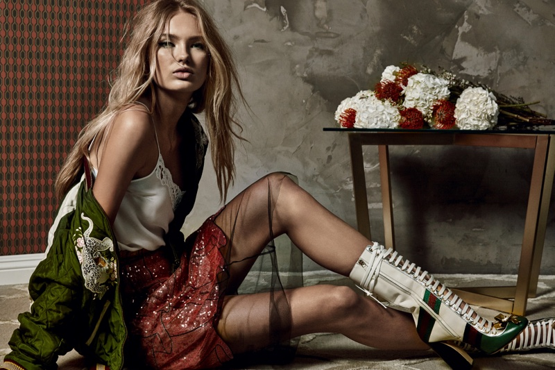 Romee Strijd poses in an embellished jacket, camisole top and sequin-embellished skirt from Gucci with lace-up boots (also from Gucci)