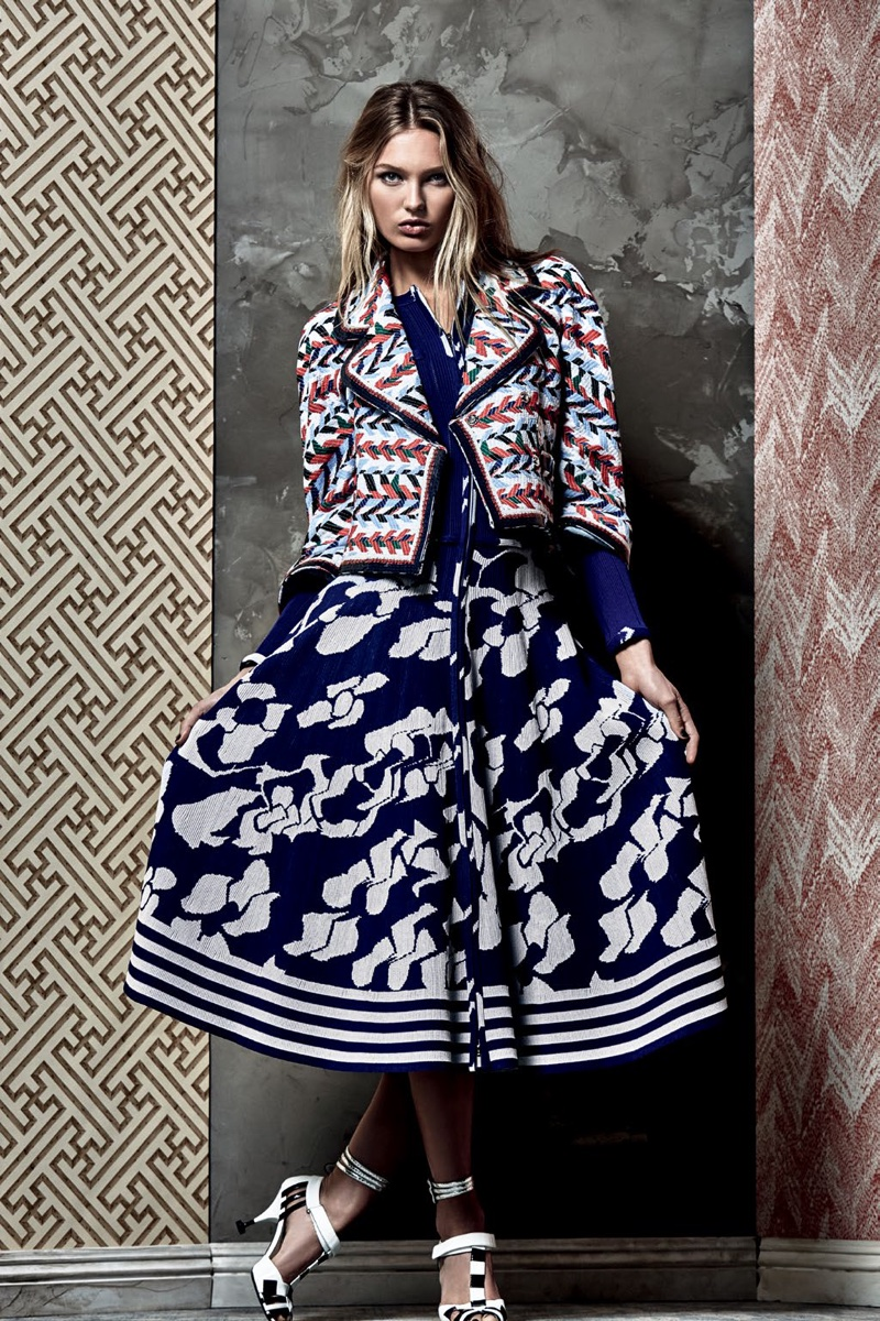 Romee Strijd poses in printed Chanel jacket and A-line skirt