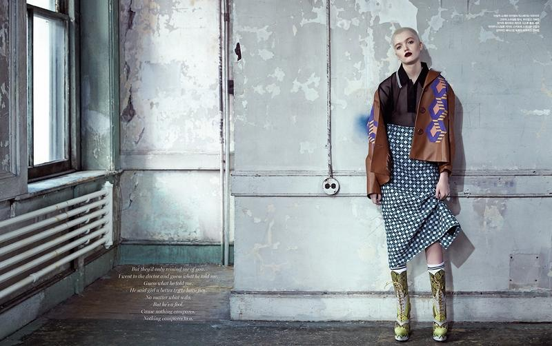 Posing in gritty setting, Ruth Bell models Miu Miu jacket, top, skirt and boots