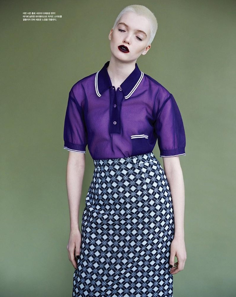 Model wears purple Miu Miu collared top with diamond print skirt