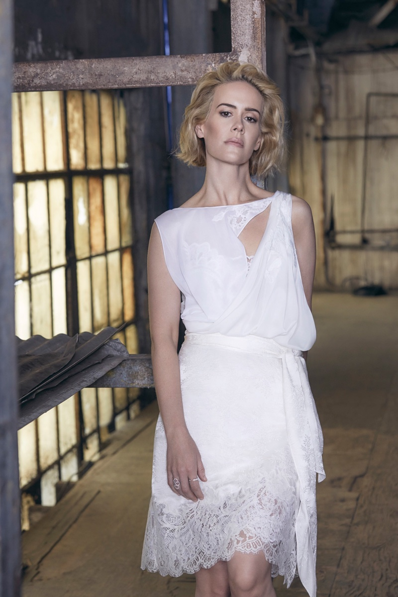 Sarah Paulson poses in a white lace top and skirt