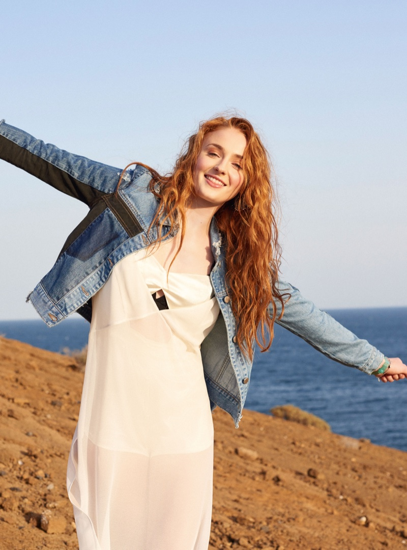 Sophie Turner is all smiles in a denim jacket and slip dress