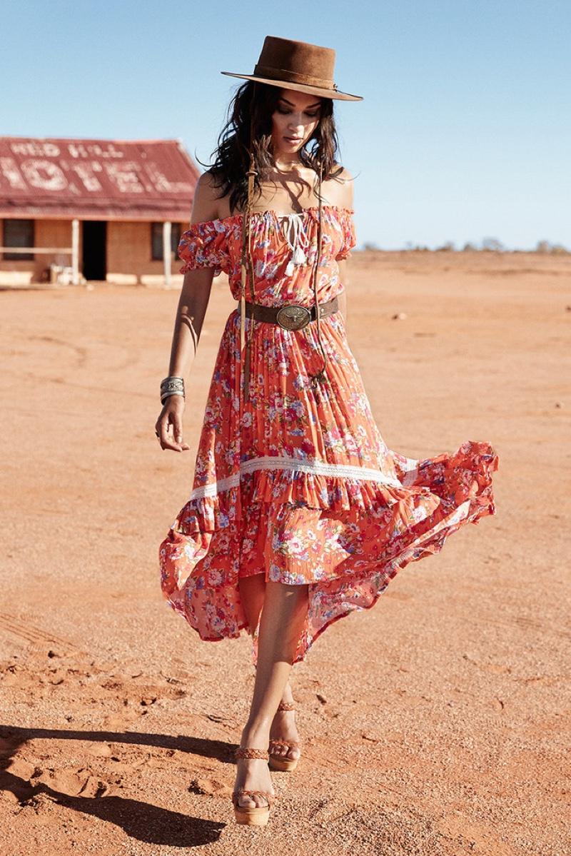 Shanina Shaik poses in the desert modeling Spell's Revolver off the shoulder dress
