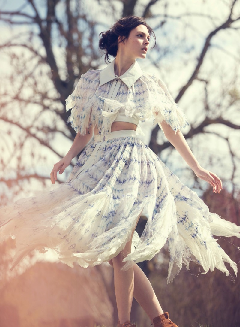 Posing outdoors, Vittoria Ceretti models Chanel top and skirt with frayed edges