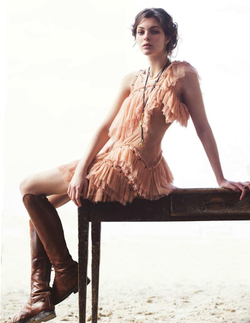 Vittoria Ceretti flaunts some skin a ruffle embellished minidress by Roberto Cavalli