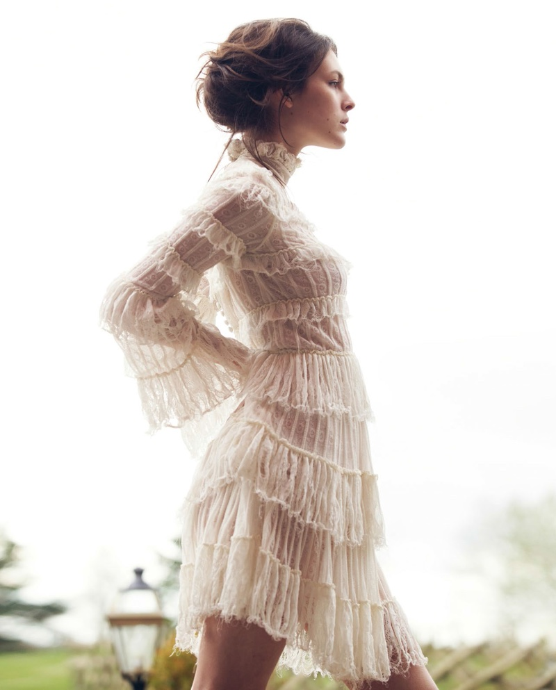 The model poses in romantic dresses from the spring collection