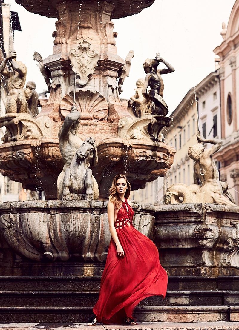 Zo Nowak wears a red Alberta Ferretti dress