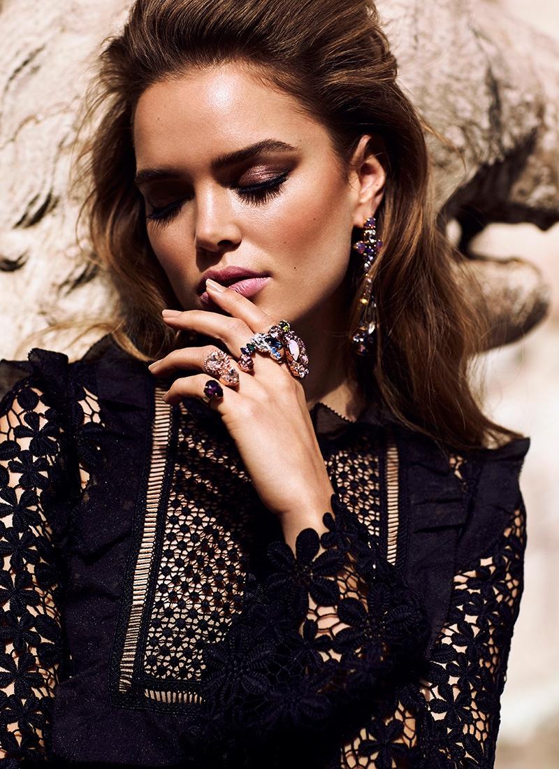 Zo Nowak wears a black Self-Portrait dress with lace detail