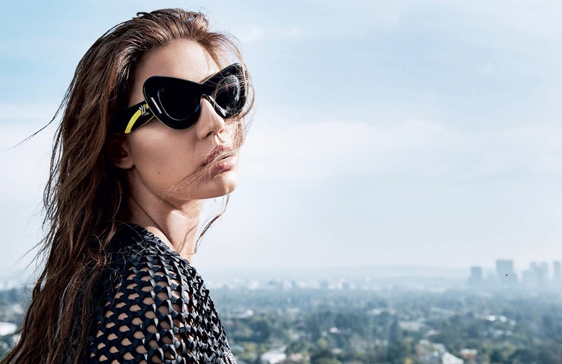 Soaking up the sun, Adèle Exarchopoulos wears Louis Vuitton sunglasses and top