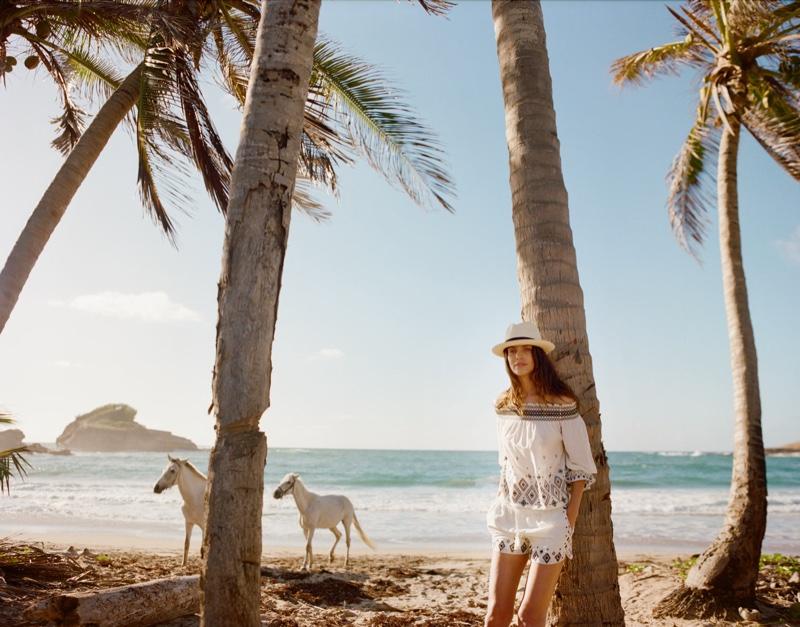 Posing on the beach, Amanda Wellsh wears Rachel Zoe top and shorts with Sensi Studio hat
