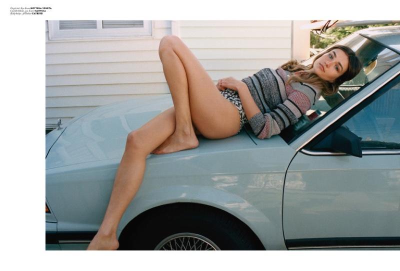 Posing on a car, Andreea Diaconu models Bottega Veneta sweater with Mariysa bikini bottoms