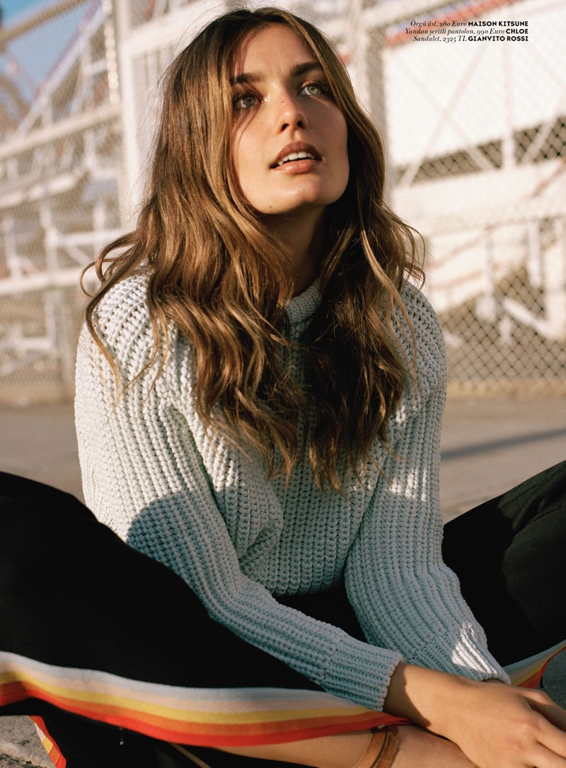 The brunette bundles up in rib-knit sweater