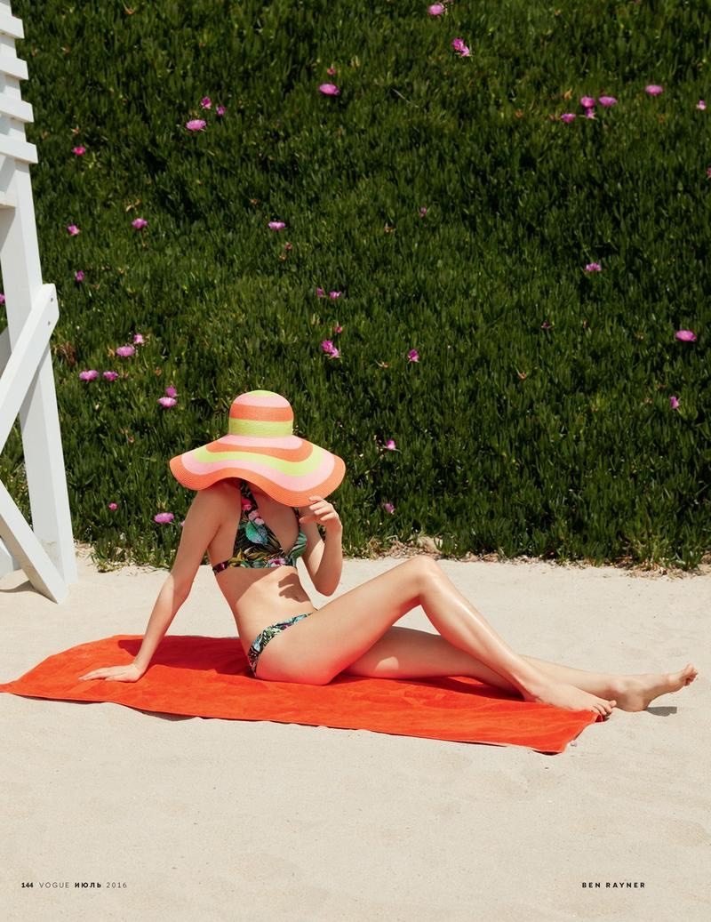 The model wears Calzedonia bikini with Eric Javits sun hat