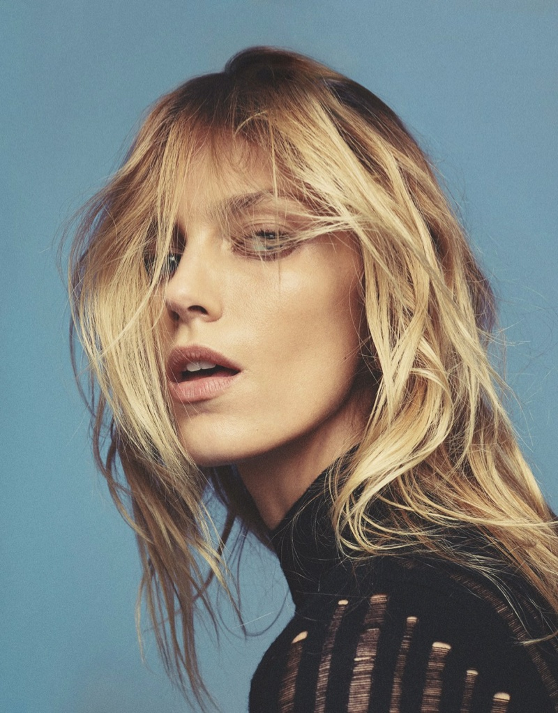 Anja Rubik poses with her hair in tousled waves