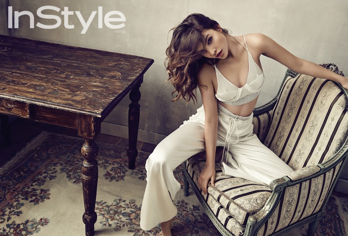 Barbara Palvin poses in Balenciaga bra top with white pants