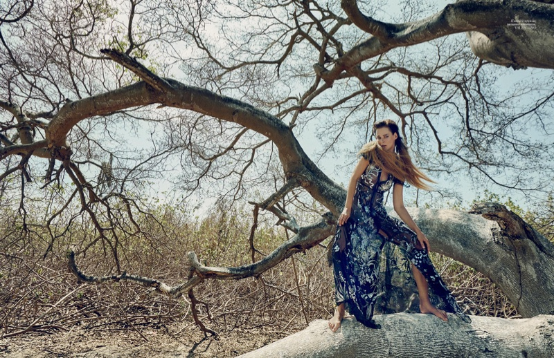 Posing outdoors, Carmen Kass models Valentino embroidered gown