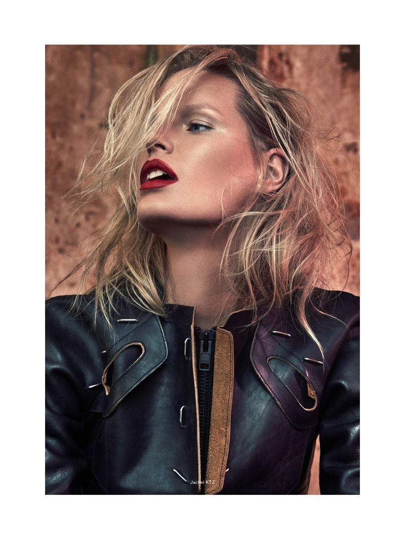 Caroline Winberg wears bold red lip color with leather jacket by KTZ