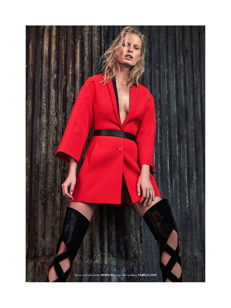 Caroline Winberg poses in Kenzo dress, belt and boots