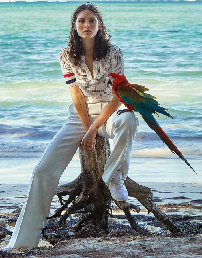 Catherine McNeil wears white polo and trousers